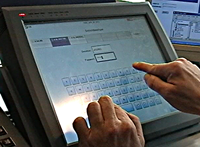 A user logging on a touchscreen device